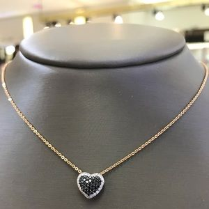 14kt Heart pendant with black and white Diamonds